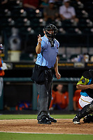 Umpire Tanner Moore calls a strike during a Florida State League game between the St. Lucie Mets and Bradenton Barbanegras on July 27, 2019 at LECOM Park in Bradenton, Florida.  Bradenton defeated St. Lucie 3-2.  (Mike Janes/Four Seam Images)
