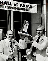 1978<br />  FILE PHOTO - ARCHIVES -<br /> <br /> Honored Montreal Canadiens' star Guy Lafleur accepts the Lou Marsh Trophy as Canada's outstanding athlete of 1977 from committee chairman Harry Red Foster.<br /> <br /> 1978<br /> <br /> PHOTO : John Mahler  - Toronto Star Archives - AQP