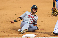 Quad Cities River Bandits infielder Alexander De Goti (10) slides into third base during a Midwest League game against the Wisconsin Timber Rattlers on April 9, 2017 at Fox Cities Stadium in Appleton, Wisconsin.  Quad Cities defeated Wisconsin 17-11. (Brad Krause/Four Seam Images)