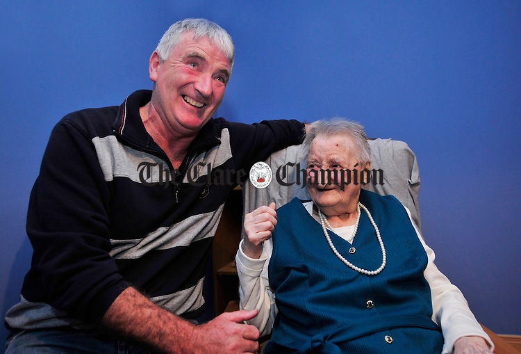 Joe Queally from Doora shares a joke with Susan Mc Inerney during her 100th birthday celebrations at her home in Doora. Photograph by Declan Monaghan