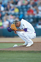 Winston-Salem Dash pitcher Jorgan Cavanerio (36) says a prayer behind the mound during the game against the Down East Wood Ducks at BB&T Ballpark on May 10, 2019 in Winston-Salem, North Carolina. The Wood Ducks defeated the Dash 9-2. (Brian Westerholt/Four Seam Images)