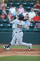 Eduardo Navas (20) of the Charleston RiverDogs follows through on his swing against the Hickory Crawdadsat L.P. Frans Stadium on August 10, 2019 in Hickory, North Carolina. The RiverDogs defeated the Crawdads 10-9. (Brian Westerholt/Four Seam Images)