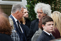 "Pictured: Brian May of The Queen (R) attends the service at Aberavon Beach Hotel in Port Talbot, Wales, UK. Monday 08 October 218<br /> Re: A grieving father will mourners on horseback at the funeral of his ""wonderful"" son who killed himself after being bullied at school.<br /> Talented young horse rider Bradley John, 14, was found hanged in the school toilets by his younger sister Danielle.<br /> Their father, farmer Byron John, 53, asked the local riding community to wear their smart hunting gear at Bradley's funeral.<br /> Police are investigating Bradley's death at the 500-pupils St John Lloyd Roman Catholic school in Llanelli, South Wales.<br /> Bradley's family claim he had been bullied for two years after being diagnosed with Attention Deficit Hyperactivity Disorder.<br /> He went missing during lessons and was found in the toilet cubicle by his sister Danielle, 12."