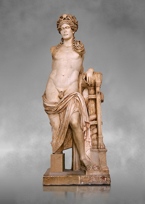 Second Century Roman statue of Apollo excavated from the Theatre of Carthage. The Bardo National Museum, Tunis, Tunisia. Inv No C939. Against a grey art background.