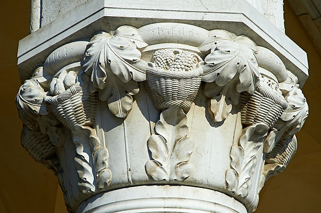 The 14th Century Gothic style column capitals of The Doge's Palace on St Marks Square, Palazzo Ducale, Venice Italy