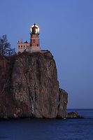 """""""Lunar Light""""<br /> <br /> The December (near) full Cold Moon rose through a pastel palette on the eve of the Supermoon. Split Rock Lighthouse and Lake Superior helped paint a serene scene for the event. As it gained altitude, the moon appeared perfectly behind the lens of the lighthouse."""