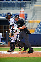Umpire Grant Hinson gets in position as catcher Jovany Felipe watches the play develop during the second game of a doubleheader between the GCL Red Sox and GCL Rays on August 4, 2015 at Charlotte Sports Park in Port Charlotte, Florida.  GCL Red Sox defeated the GCL Rays 2-1.  (Mike Janes/Four Seam Images)