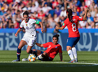 PARIS,  - JUNE 16: Carli Lloyd #10 steps away from the tackle of Maria Jose Urrutia #9 during a game between Chile and USWNT at Parc des Princes on June 16, 2019 in Paris, France.