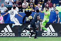 CARSON, CA - SEPTEMBER 29: Uriel Antuna #18 of the Los Angeles Galaxy takes a shot on GK Maxime Crepeau #16 of the Vancouver Whitecaps during a game between Vancouver Whitecaps and Los Angeles Galaxy at Dignity Health Sports Park on September 29, 2019 in Carson, California.