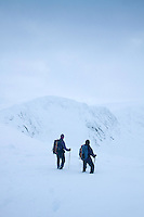 Two walkers looking towards Stob Coire an t-Sneachda from the Central Cairngorm Plateau, Cairngorm National Park, Badenoch & Speyside