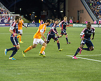 Houston Dynamo forward Will Bruin (12) converges on the Revolution goal as defenders move in.   The New England Revolution played to a 1-1 draw against the Houston Dynamo during a Major League Soccer (MLS) match at Gillette Stadium in Foxborough, MA on September 28, 2013.