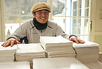 Japanese baker, Mizuki Taira, 36,  in their home bakery called Gateau d'Ange, Kamakura, Japan 09 Feb 11, look at the eight year waiting list piled-up.  Mizuki Taira, turned to baking after a nasty bicycle accident, as part of his rehabilitation.
