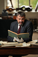 BNPS.co.uk (01202) 558833<br /> Pic:  ZacharyCulpin/BNPS<br /> <br /> Pictured: Auctioneer, Matthew Day goes through log books<br /> <br /> The fascinating logbooks of a hero Spitfire pilot who escorted Winston Churchill over the Rhine have been discovered during a house clearance.<br /> <br /> Flight Officer Joseph Staples, of 74 Squadron, 145 Wing, racked up hundreds of missions during World War Two.<br /> <br /> In early 1945, he flew alongside Allied bombers on German raids to protect them from the constant Luftwaffe threat.<br /> <br /> His dangerous sorties were all recorded in his meticulously-kept logbooks alongside very matter-of-fact descriptions of them.