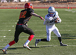 Whittell's Palmer Chaplin chases Pahranagat Valley's Cody Williams during the first half of the NIAA Division IV championship game at Dayton High School in Dayton, Nev., on Saturday, Nov. 21, 2015. Pahranagat Valley won 54-28. (Cathleen Allison/Las Vegas Review Journal)