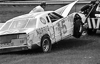 Bobby Allison's  #15 Ford is towed away after crash, 27th place finish, 1978 Firecracker 400 NASCAR race, Daytona International Speedway, Daytona Beach, FL, July 4, 1978.  (Photo by Brian Cleary/ www.bcpix.com )