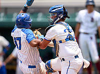 Tampa Jesuit Tigers catcher Cole Russo (22) tags Juan Aracena (17) during the 42nd Annual FACA All-Star Baseball Classic on June 5, 2021 at Joker Marchant Stadium in Lakeland, Florida.  (Mike Janes/Four Seam Images)