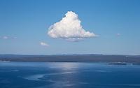 A single cloud dominates the skyline above Yellowstone Lake.