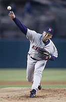 Rick Reed of the Minnesota Twins pitches during a 2002 MLB season game against the Los Angeles Angels at Angel Stadium, in Anaheim, California. (Larry Goren/Four Seam Images)