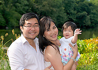 Mom and dad portrait with baby in Central Park