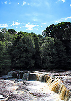 Aysgarth Fallsare a triple flight ofwaterfalls, carved out by theRiver Ureon its descent tomid-Wensleydalein theYorkshire DalesofEngland All three falls were featured in the filmRobin Hood: Prince of Thieves. Aysgarth, Yorkshire on August 7th 2020<br /> <br /> Photo by Keith Mayhew