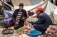 Morocco.  Vegetable vendors Talking over Tea, Had Draa Market, Essaouira Province.
