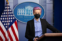 US soccer player Megan Rapinoe stands at the podium during a visit in the James Brady Press Briefing Room of the the White House in Washington, DC, USA, 24 March 2021.<br /> CAP/MPI/RS<br /> ©RS/MPI/Capital Pictures