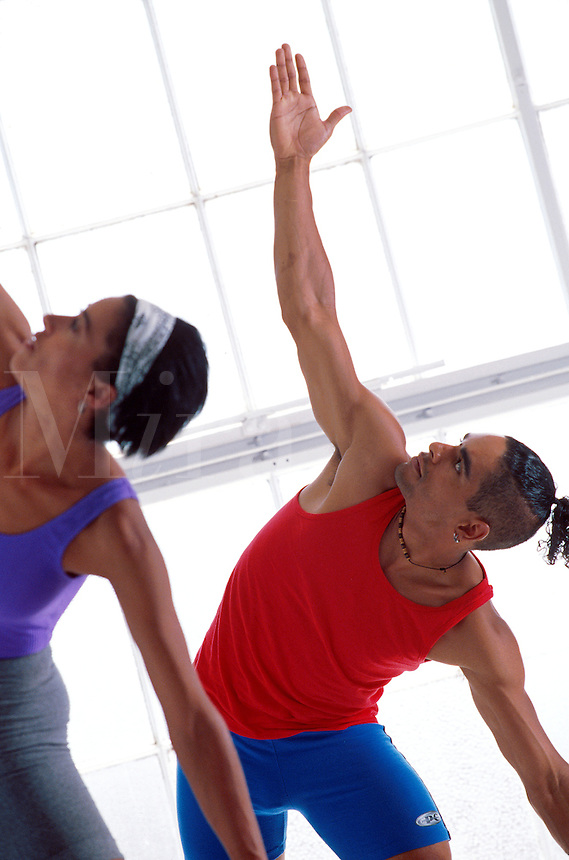 Man and woman practicing yoga together.