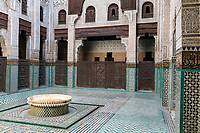 Meknes, Morocco.  Medersa Bou Inania, 14th. Century.  Inner Courtyard and Fountain.
