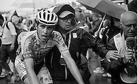 Alberto Contador (ESP/Tinkoff-Saxo) escorted out straight after finishing<br /> <br /> stage 12: Lannemezan - Plateau de Beille (195km)<br /> 2015 Tour de France