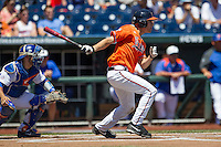 Virginia Cavaliers outfielder Adam Haseley (7) follows through on his swing against the Florida Gators in Game 11 of the NCAA College World Series on June 19, 2015 at TD Ameritrade Park in Omaha, Nebraska. The Gators defeated Virginia 10-5. (Andrew Woolley/Four Seam Images)