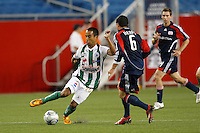 Santos Laguna midfielder Francisco Javier Torres (26) and New England Revolution defender Jay Heaps (6). The New England Revolution defeated Santos Laguna 1-0 during a Group B match of the 2008 North American SuperLiga at Gillette Stadium in Foxborough, Massachusetts, on July 13, 2008.