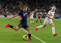 ORLANDO, FL - MARCH 05: Tobin Heath #17 of the United States crosses the ball during a game between England and USWNT at Exploria Stadium on March 05, 2020 in Orlando, Florida.