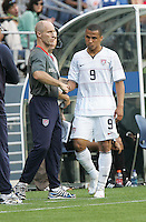 Bob Bradley (left) shakes hands with Charlie Davies (9) coming off the field. USA defeated Grenada 4-0 during the First Round of the 2009 CONCACAF Gold Cup at Qwest Field in Seattle, Washington on July 4, 2009.