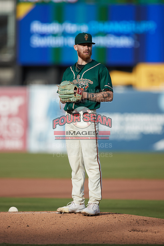Greensboro Grasshoppers starting pitcher Michael Burrows (50) looks to his catcher for the sign against the Winston-Salem Dash at First National Bank Field on June 3, 2021 in Greensboro, North Carolina. (Brian Westerholt/Four Seam Images)