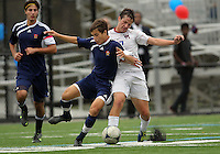 HYATTSVILLE, MD - OCTOBER 26, 2012:  Christian Cooke (7) of DeMatha Catholic High School is tackled by Chris Fleisher (25) of St. Albans during a match at Heurich Field in Hyattsville, MD. on October 26. DeMatha won 2-0.