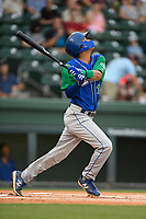 Shortstop Jeison Guzman (11) of the Lexington Legends follows through on a swing during a game against the Greenville Drive on Sunday, September 2, 2018, at Fluor Field at the West End in Greenville, South Carolina. Greenville won, 7-4. (Tom Priddy/Four Seam Images)