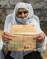 "Palestinian woman  Rasmia Al-akaras 78 years presented a paper proving the ownership of the house in Wadi Hanin Village beside  Beersheba  in the occupied territories in 1948 in the 59 anniversary of the catastrophe ""Nakba59""she live now in Rafah Refugee camp 15.May.2007.""photo by Fady Adwan"""