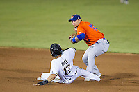 Midland RockHounds shortstop Darwin Perez (17) attempts to turn a double play as San Antonio Missions base runner Rico Noel (17) slides into him during the Texas League baseball game on July 13, 2013 at Nelson Wolff Municipal Stadium in San Antonio, Texas. The Missions defeated the Rock Hounds 5-4. (Andrew Woolley/Four Seam Images)
