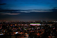 BOGOTA, COLOMBIA - MAY 6: The Movie Star Arena is seen lit in Colombia's flash colors on May 6, 2021. In Bogota, Colombia. Violent clashes between protesters and riot police in Colombia continue after President Iván Duque ordered Congress to withdraw his tax reform law on Sunday. The international community reported that at least 19 people died, there are more than 846 injured and there are also missing people. (Photo by Leonardo Munoz/VIEWpress )