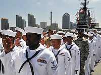 100702-N-7981E-447 .SAN DIEGO (July 2, 2010) Service members recite the oath of citizenship during a naturalization ceremony on the flight deck of the USS Midway Museum. Three hundred service members from 51 countries became U.S. citizens during the ceremony sponsored by U.S. Citizenship and Immigration Services. (U.S. Navy photo by Mass Communication Specialist 2nd Class James R. Evans/Released).