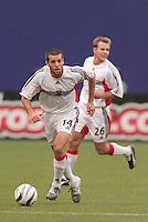 D.C. United's Ben Olsen is trailed by Bryan Namoff. D. C. United was defeated by the NY/NJ MetroStars 3 to 2 during the MetroStars home opener at Giant's Stadium, East Rutherford, NJ, on April 17, 2004.