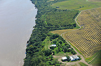 URUGUAY Bella Union, 2100 hectares farm with paddy, aerial view of Farm of Karol Pinczak with paddy fields and Hangar for his Cessna at River Rio Uruguay/ URUGUAY Bella Uniòn , 2100 Hektar Reis Farm der Brueder Karol und Aleco Pinczak, Nachkommen polnischer Einwanderer, Reisfelder am Fluss Rio Uruguay und Hangar fuer Kleinflugzeug Cessna von Farmer Karol Pinczak