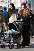 Tripoli, Libya, North Africa - Libyan Women with Baby Buggy at International Trade Fair.  Clothing Styles.