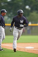 GCL Yankees West right fielder Jordan Scott (18) runs home during the first game of a doubleheader against the GCL Yankees East on July 19, 2017 at the Yankees Minor League Complex in Tampa, Florida.  GCL Yankees West defeated the GCL Yankees East 11-2.  (Mike Janes/Four Seam Images)