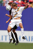 The MetroStars' Chris Leitch goes up for a header with the Galaxy's Sasha Victorine. The LA Galaxy were defeated by the NY/NJ MetroStars 2 to 1 at Giant's Stadium, East Rutherford, NJ, on June 19, 2004.