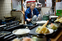 MAY 15, 2014 - KOJIMA, KURASHIKI, JAPAN: A chef wearing Happi coat made of Denim fabric, while cooks in the counter at  Udon nudle restaurant .  (Photograph / Ko Sasaki)