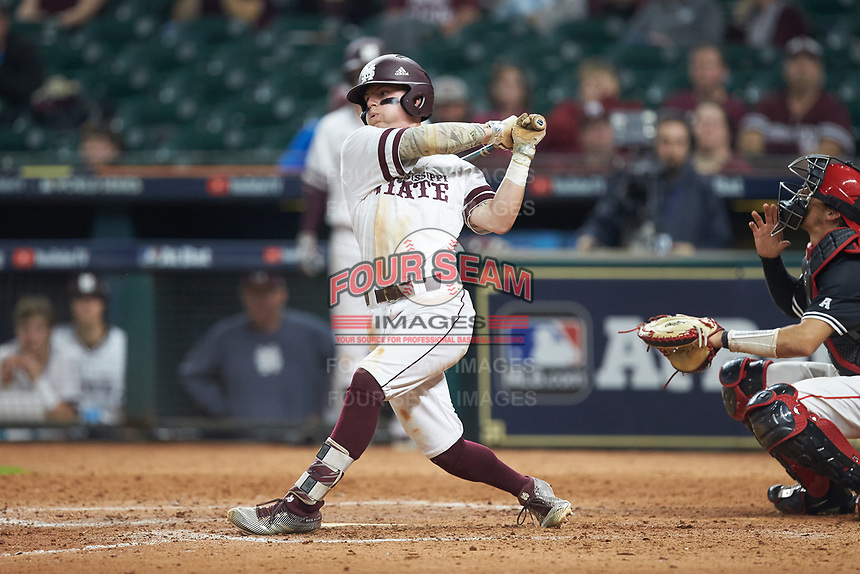 Hunter Stovall (13) of the Mississippi State Bulldogs follows through on his swing against the Houston Cougars in game six of the 2018 Shriners Hospitals for Children College Classic at Minute Maid Park on March 3, 2018 in Houston, Texas. The Bulldogs defeated the Cougars 3-2 in 12 innings. (Brian Westerholt/Four Seam Images)