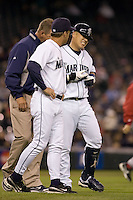 September 24, 2008: Seattle Mariners' Kenji Johjima grimaces in pain after getting drilled by a pitch during a game against the Los Angeles Angels of Anaheim at Safeco Field in Seattle, Washington..