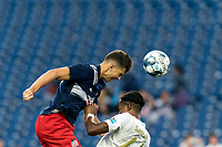 FOXBOROUGH, MA - AUGUST 5: Colin Verfurth #35 of New England Revolution II heads the ball during a game between North Carolina FC and New England Revolution II at Gillette Stadium on August 5, 2021 in Foxborough, Massachusetts.