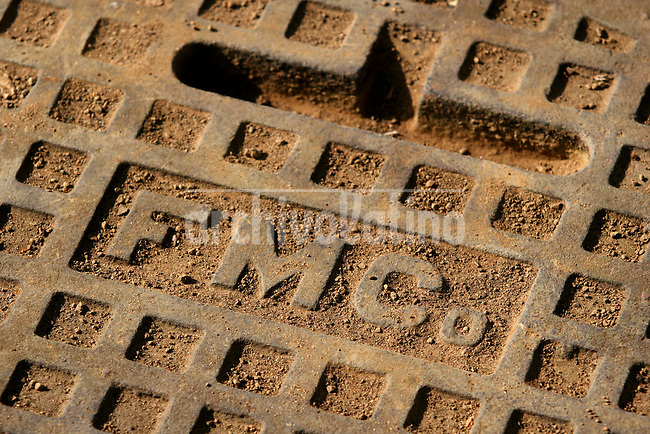 A manhole cover bears the initials of the Ford Motor Company in Fordlandia, a former factory town created by the company on the banks of the Tapajós River, September 6, 2005. Deep in the Amazon forest, 12 hours by boat from the regional capital of Santarem in Brazil's Pará state, the rubber plantation and processing factory is now abandoned to the rain-forest, an aging memorial to American ideals and to the Brazilian reality. It almost seems like time has stopped in Fordlandia, or better yet, time has passed it by. In typical american style, it was organized and efficient, an idea admired by many Brazilians, and perhaps more so by residents of the untamed Amazon. But It is an idea hard to implement in the wilds of the amazon. Some might also say that it is also a typical American style the way Ford came here and tried to implement something with little knowledge of the local customs or terrain. From 1928 to 1945, Ford came tried to take control of his rubber supply, one of the most important products of the rainforest. After only 17 years the company admitted defeat and retreated from the forest.